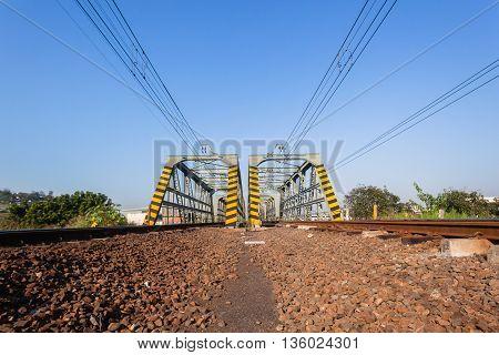 Railway bridge tracks lines closeup crossing city to countryside
