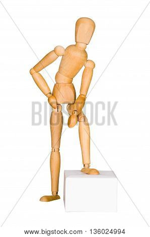 Wooden mannequin lean on the box.  Isolated on white.