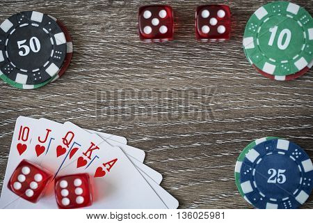 Gambling chips frame on wooden card table background