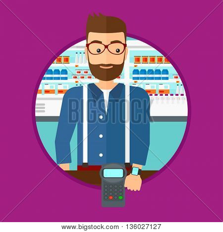 A hipster man paying wireless with his smart watch at the supermarket. Male customer making payment for purchase with smart watch. Vector flat design illustration in the circle isolated on background.