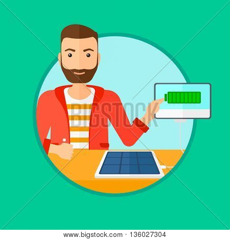 Hipster man charging tablet computer with solar panel. Charging tablet from portable solar panel. Tablet with a battery charging. Vector flat design illustration in the circle isolated on background.