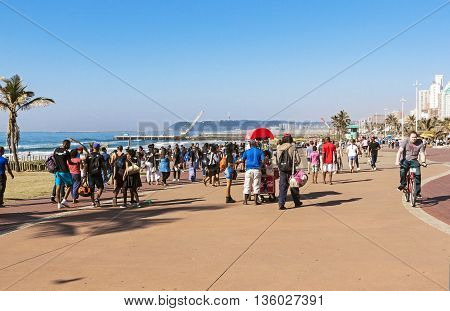 People And Cyclists On  Promenade On Beach Front 1
