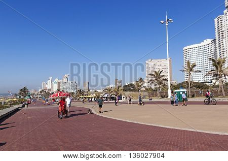 People On Promenade Against City Skyline 3