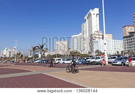 People On Promenade Against City Skyline 2