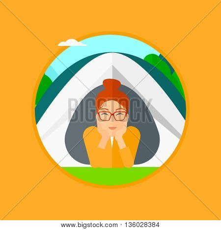 Young woman crawling out from a camping tent. Travelling woman with her hands on cheek lying in camping tent and relaxing. Vector flat design illustration in the circle isolated on background.