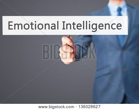 Emotional Intelligence - Businessman Hand Holding Sign
