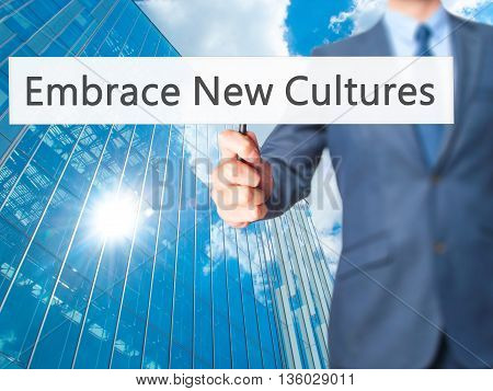 Embrace New Cultures - Businessman Hand Holding Sign