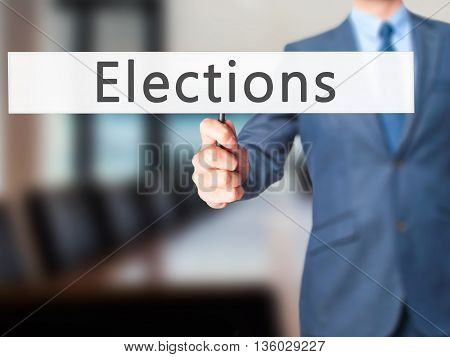 Elections - Businessman Hand Holding Sign