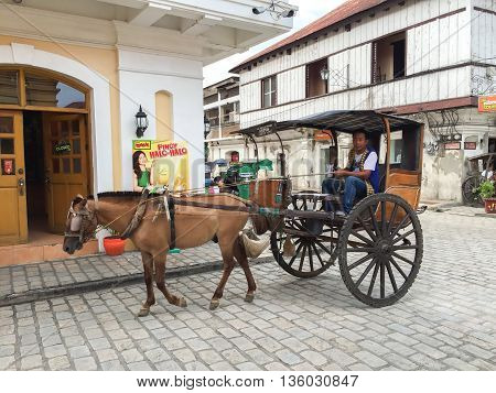 Vigan Philippines - July 25 2015 : A Kalesa (or Horse Carriage) in Historic Town of Vigan. Vigan is a UNESCO World Heritage Site in that it is one of the few Spanish colonial town