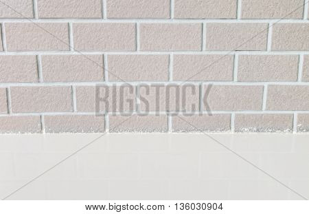 Closeup brick pattern at brick wall with marble stone floor textured background