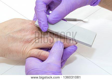 woman doing manicure beauty salon varnish wellness