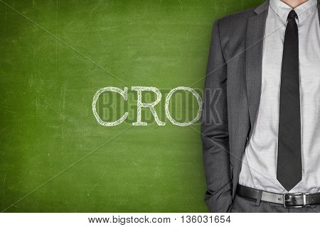 CRO on blackboard with businessman in a suit on side