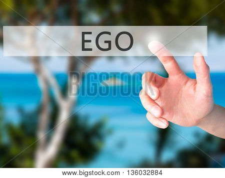 Ego - Hand Pressing A Button On Blurred Background Concept On Visual Screen.