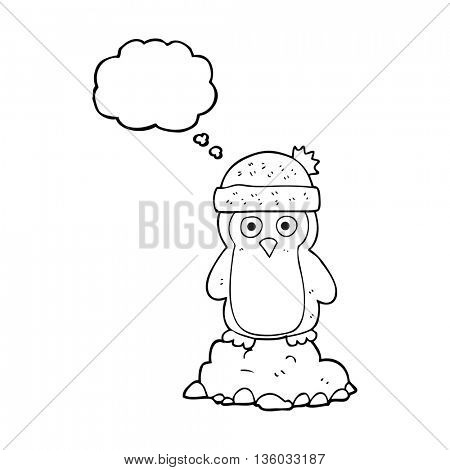 freehand drawn thought bubble cartoon penguin wearing hat