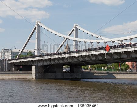 Moscow - May 9 2016: A lot of people are on the Crimean bridge to visit and relax in the Gorky Park May 9 2016 Moscow Russia