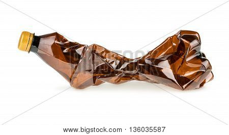 Crumpled brown plastic bottle on white background
