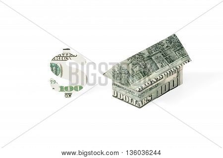 House origami folded from dollars and dollar sign carved out of hundred dollar bills isolated on white background