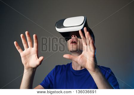 Excited young man using a VR googles.