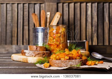 Open sandwich with steamed vegetables on a wooden background. Selective focus.