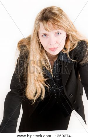 An Angry Business Woman Leaning Across A Desk