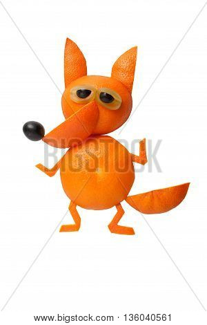 Dancing fox made of oranges on isolated background
