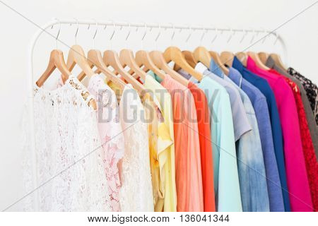 Clothes in the closet hanging on hangers