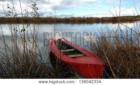 Red boat, Rocha lagoon, Uruguay. Natural reserve.