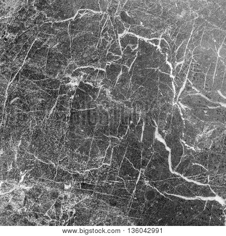 Closeup surface marble pattern at the black marble stone wall texture background