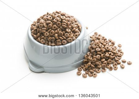 Dry kibble dog food in bowl  isolated on white background.