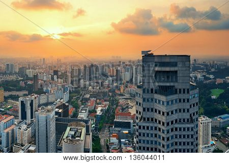 Singapore rooftop view with urban skyscrapers at sunset.
