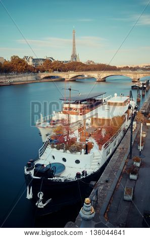 Paris River Seine with Eiffel Tower and boat in France.