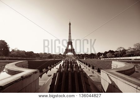 Eiffel Tower with fountain pipe as the famous city landmark in Paris