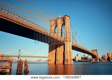 Brooklyn bridge at waterfront in downtown Manhattan New York City.