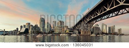Vancouver False Creek panorama at sunset with bridge and boat.