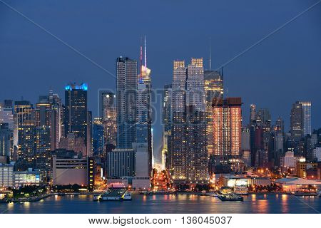 Manhattan midtown skyscrapers and New York City skyline at night