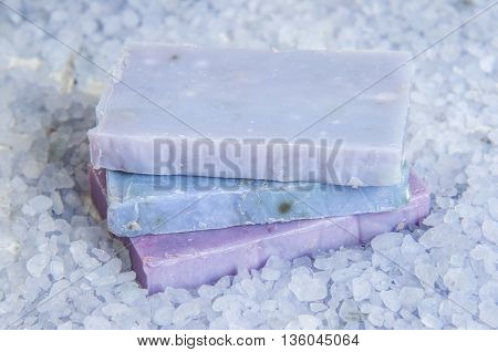Natural soap, lavender, salt on a wooden board, hygiene items for bath and spa. Relax concept.