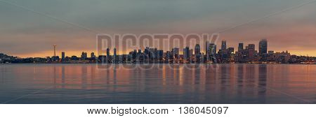 Seattle city skyline view over sea at sunrise with urban architecture.