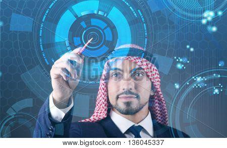 Arab man pressing virtual buttons in futuristic concept
