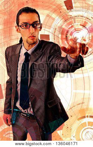 Businessman pressing virtual buttons in futuristic concept