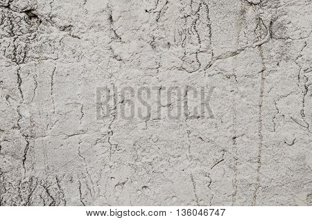 Texture of old concrete wall with cracks, color gray
