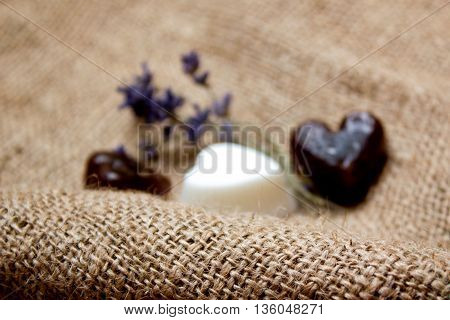 Decorative Blurred Background With Set Of Heart Soaps And Lavender Twigs On Jute Underlay