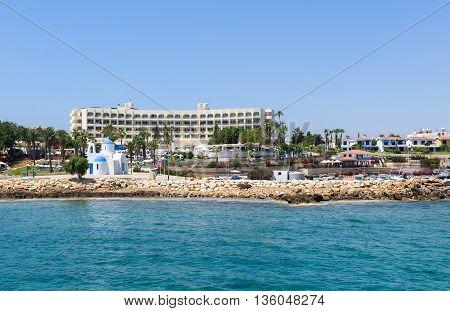 Traditional agios nikolaos church and hotel in protaras paralimni white church cyprus island