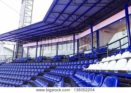 Empty blue seats in stadium for sport and concert