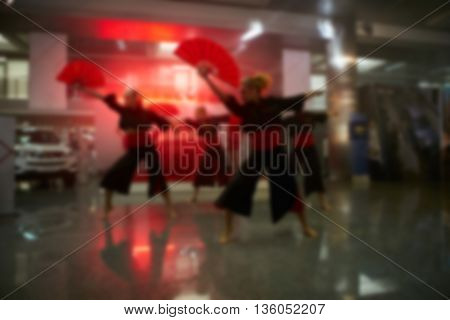 Blurred background: Bokeh lighting in concert with audience. Music showbiz concept