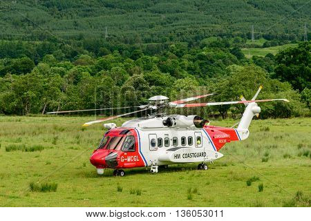 KILLIN SCOTLAND - JUNE 27 2016: HM Coastguard helicopter landed at refuelling point near the village of Killin in Perthshire Scotland.