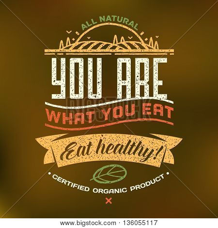 You are what you eat - Eat healthy. Healthy eating quote on brown blurred background. Natural, locally grown, organic food poster or banner. Vector illustration.