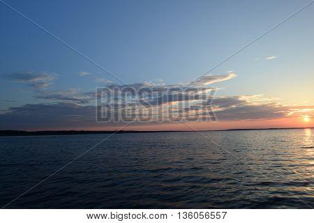 Sunset evening summer sun on the horizon drifting