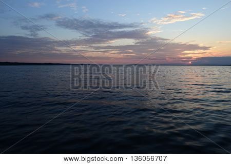 Sunset on the lake with a glow on the water surface