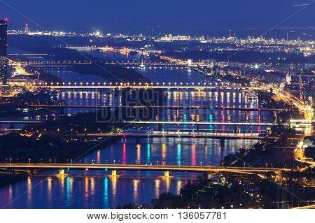 Bridges on Danube River at night. Vienna Austria.