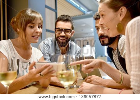Group of friends taking selfie pictures in bar